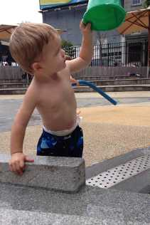 Henry empties a bucket.