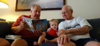 Story time with Uncle Chris and Paw Paw Butch.