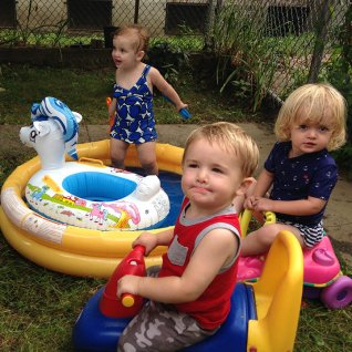 Vera, Henry and Isla near the kiddie pool.