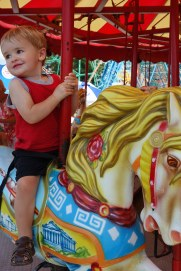Henry was exited to mount a carousel horse.