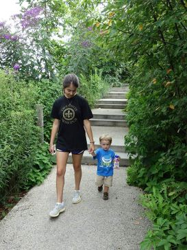 Shannon and Henry walk through the park.