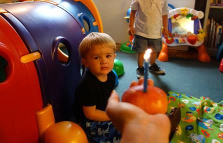 Henry gets ready to blow out his two candles