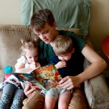 Blue reading to Mae and Henry