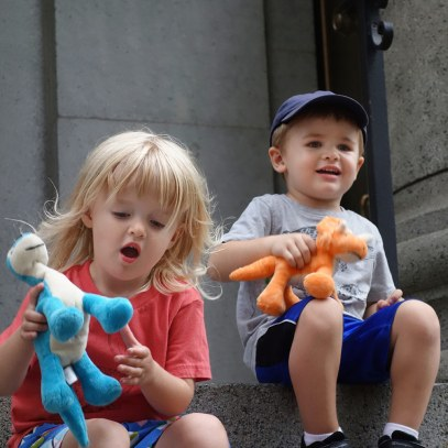 Isla and Henry with their dinosaur puppets.