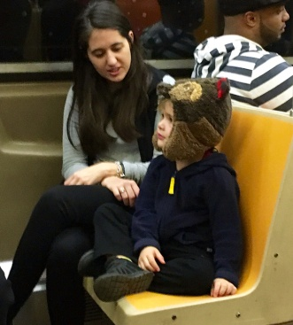 Serious talk with a bear on the subway.